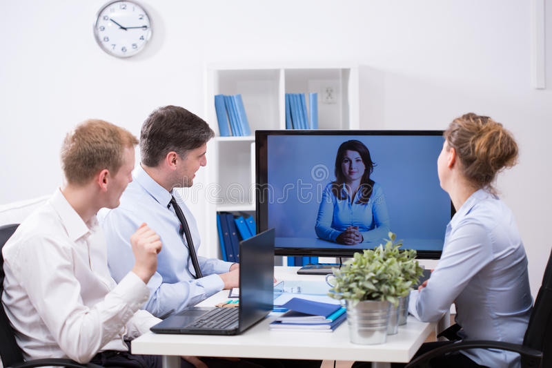 Business team having web conference royalty free stock image