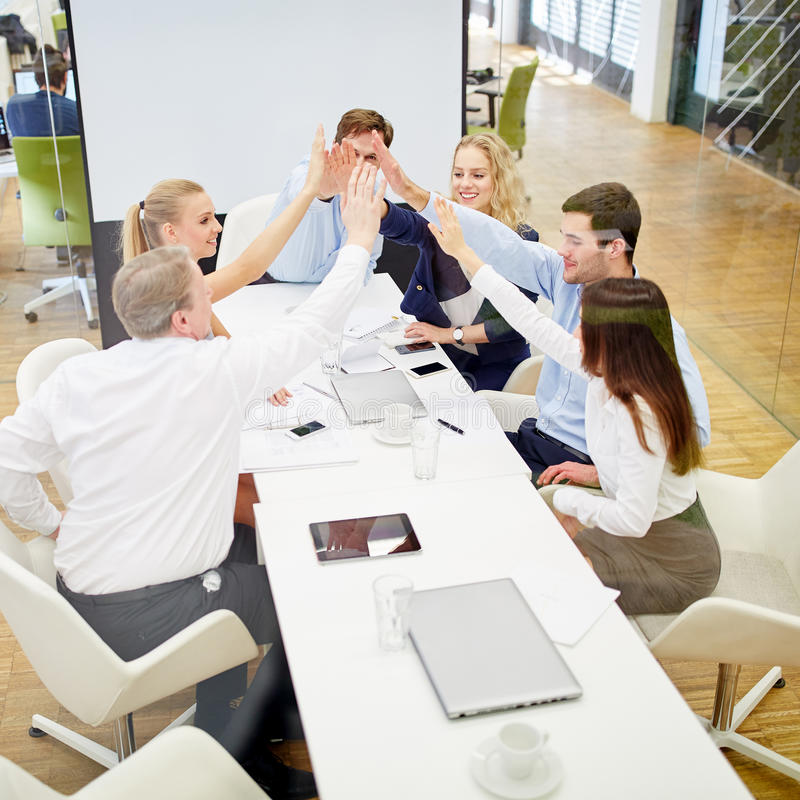 Business team with high five as a success concept. Business team with high five in a conference as a success concept stock images