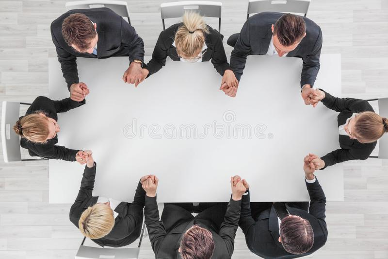 Business team holding hands stock images