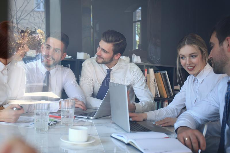 Business team is holding a meeting hrough the glass royalty free stock photos