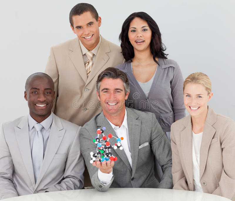 Download Business Team Holding Molecules In The Office Stock Image - Image of businesswoman, blonde: 11948881