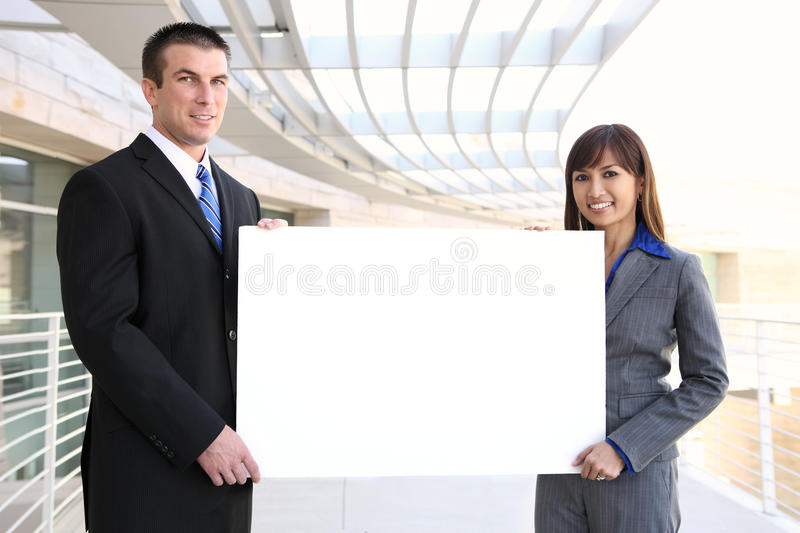 Business Team Holding Sign royalty free stock photos