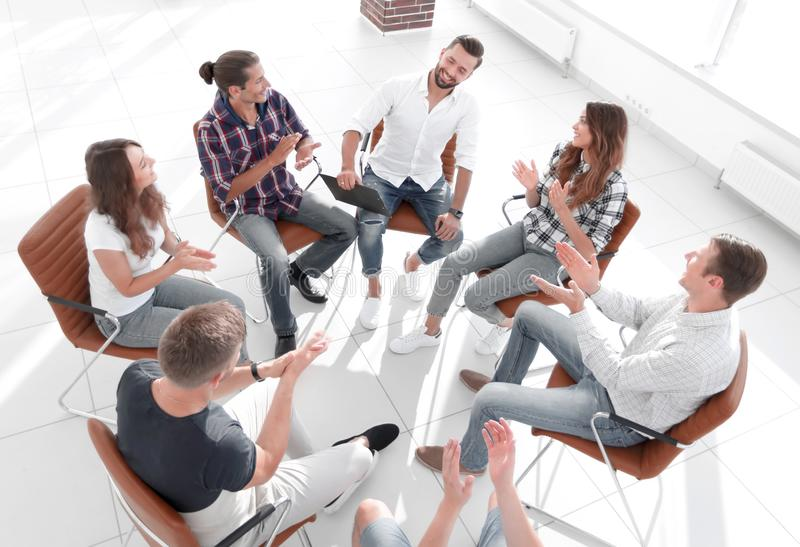 Business team holds a meeting in the lobby of the office stock image