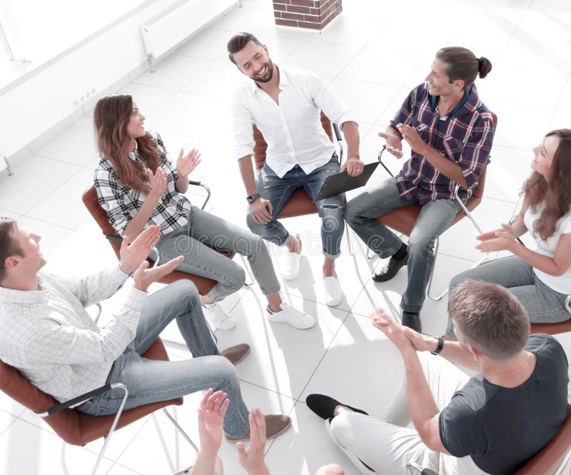 Business team holds a meeting in the lobby of the office. The concept of teamwork royalty free stock photo