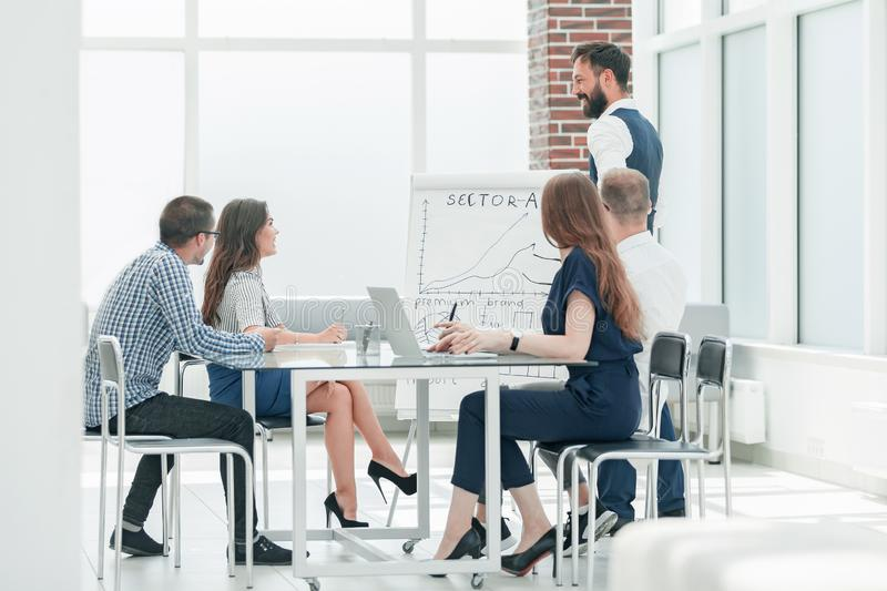 Business team holds a meeting in a modern office stock photography