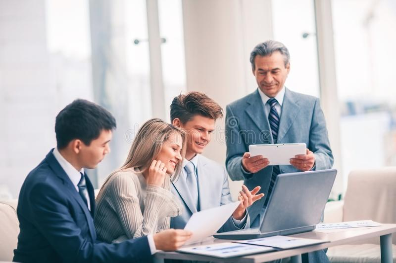 Successful business team discussing a plan of the company in the office royalty free stock photo