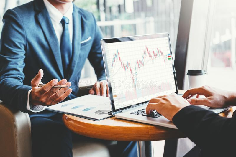 Business Team Investment Entrepreneur Trading discussing and analysis graph stock market trading,stock chart concept.  stock photo