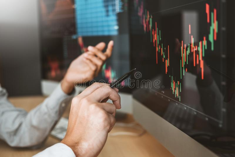 Business Team Investment Entrepreneur Trading discussing and analysis graph stock market trading,stock chart concept stock photo.  stock image