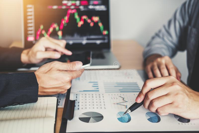 Business Team Investment Entrepreneur Trading discussing and analysis graph stock market trading,stock chart concept.  stock image
