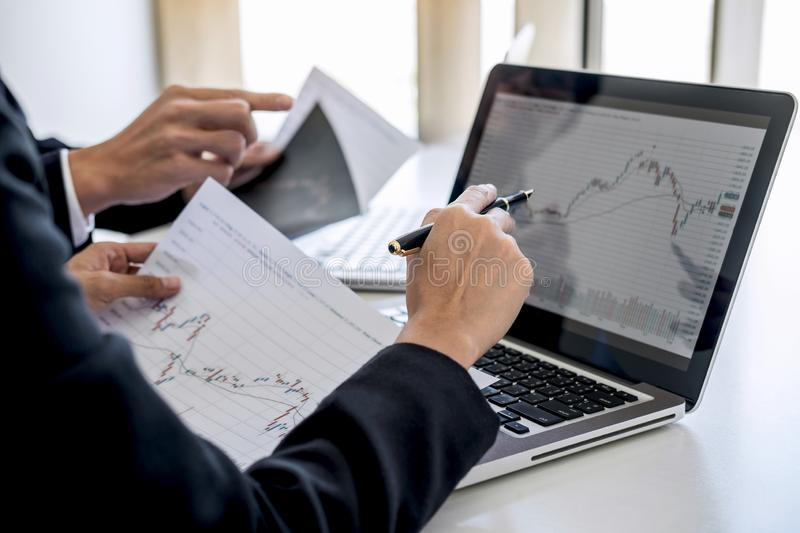 Business team investment working with computer and analysis graph stock market trading with stock chart data, business and stock images