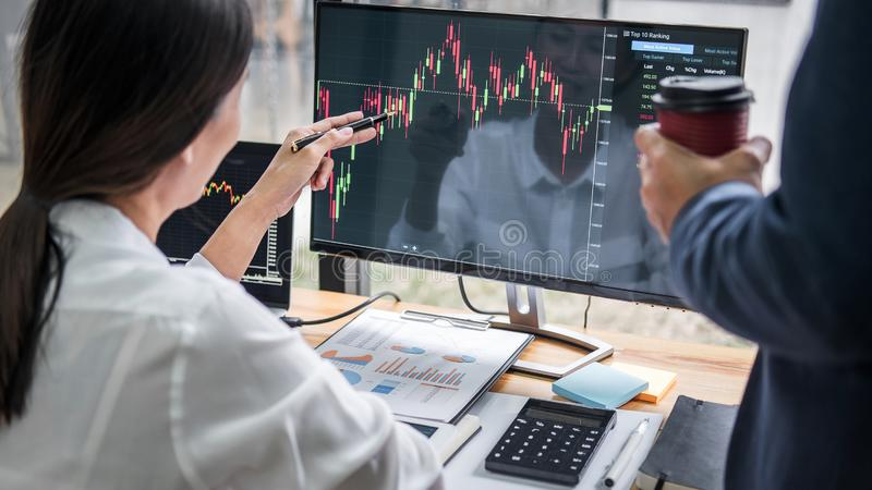 Business team investment working with computer, planning and analyzing graph stock market trading with stock chart data, business stock photography