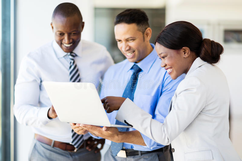 Business team laptop computer. Modern business team using laptop computer in office stock photography