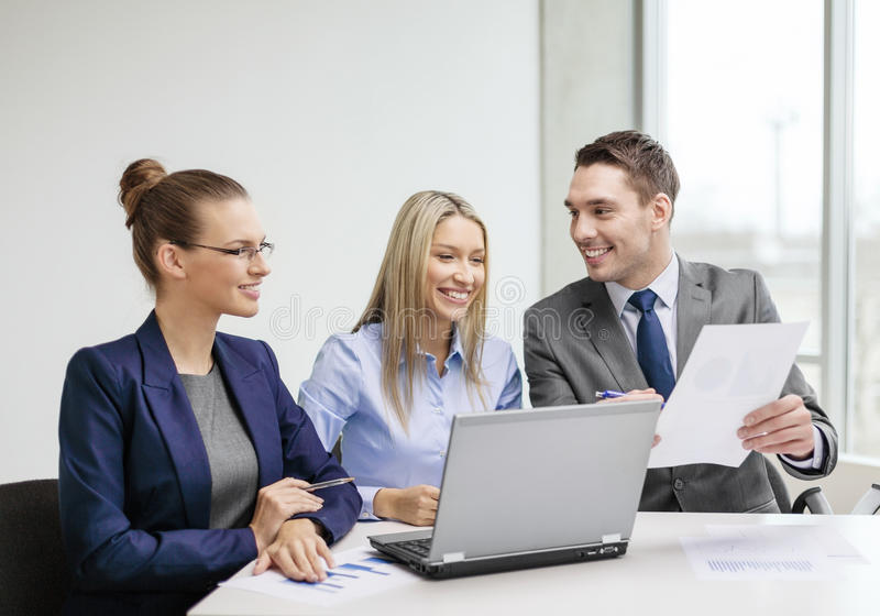 Business team with laptop having discussion stock photography