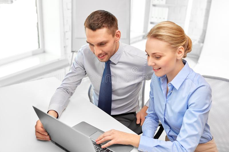 Business team with laptop at office royalty free stock photo