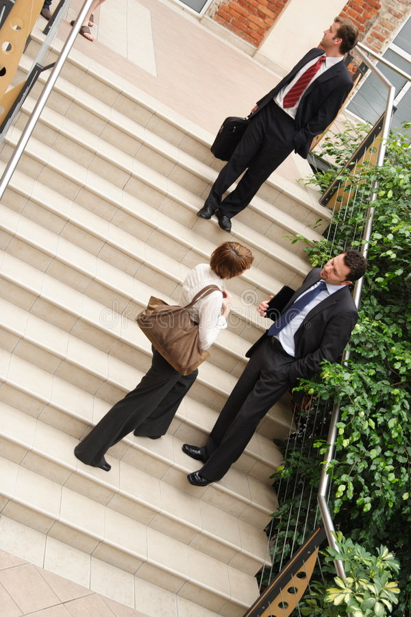 Business team leaving building stock images
