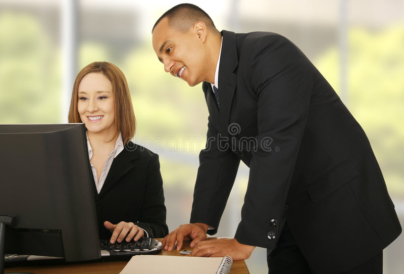 Download Business Team Looking At Compiter Stock Photos - Image: 5691353