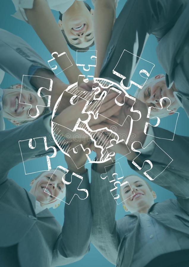 Business team looking down putting hands together behind white jigsaw doodle and against blue backgr stock images