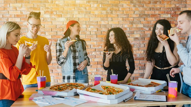 Business team lunch pizza lifestyle millennials stock photos