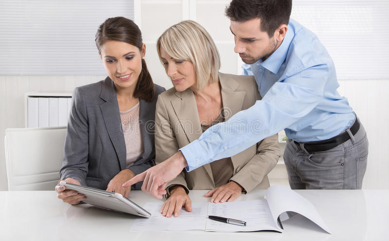 Business Team: Man and woman group in a meeting talking about fa royalty free stock photo