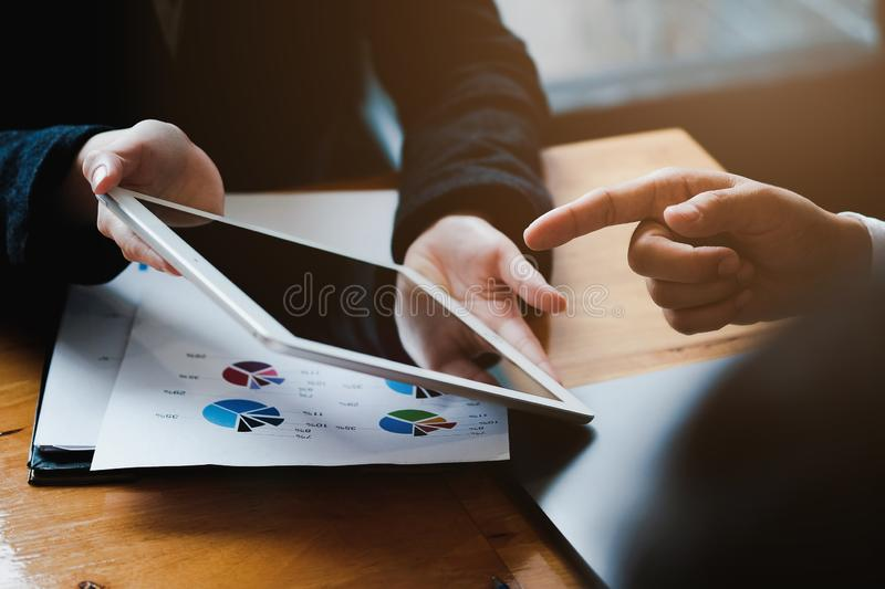Business team meeting and discussing with financial analyst business development strategy project and using modern digital tablet stock photos
