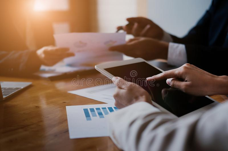 Business team meeting and discussing with financial analyst business development strategy project and using modern digital tablet royalty free stock images
