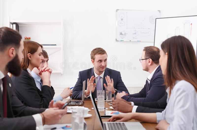 Dealing meeting. Emotional discussion of financial plan with the boss royalty free stock photography