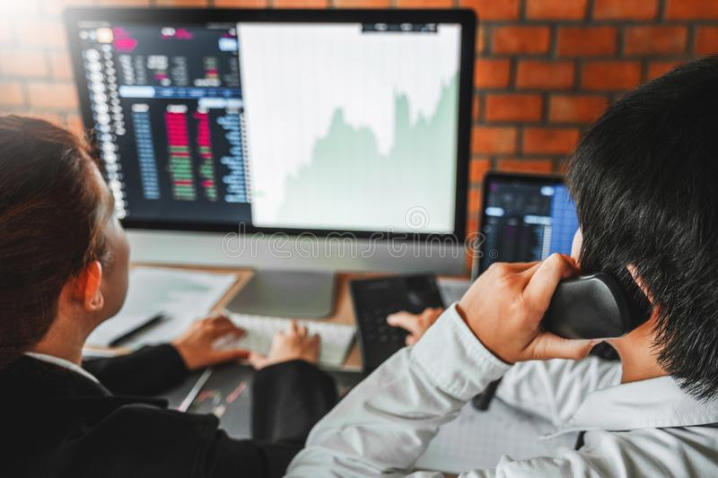 Business Team meeting Investment and Entrepreneur Trading Stock Market and Exchange discussing and analysis graph royalty free stock images