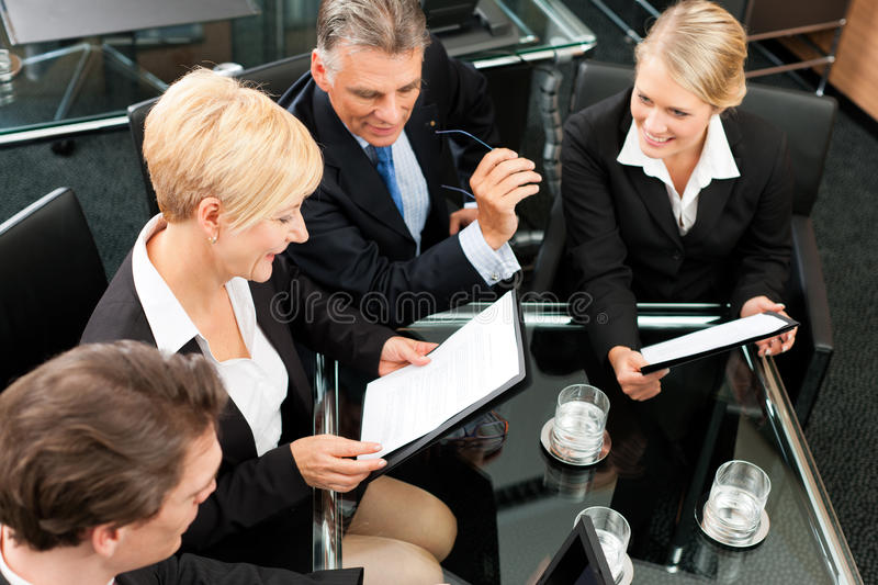 Business - Team Meeting In An Office Royalty Free Stock Photo