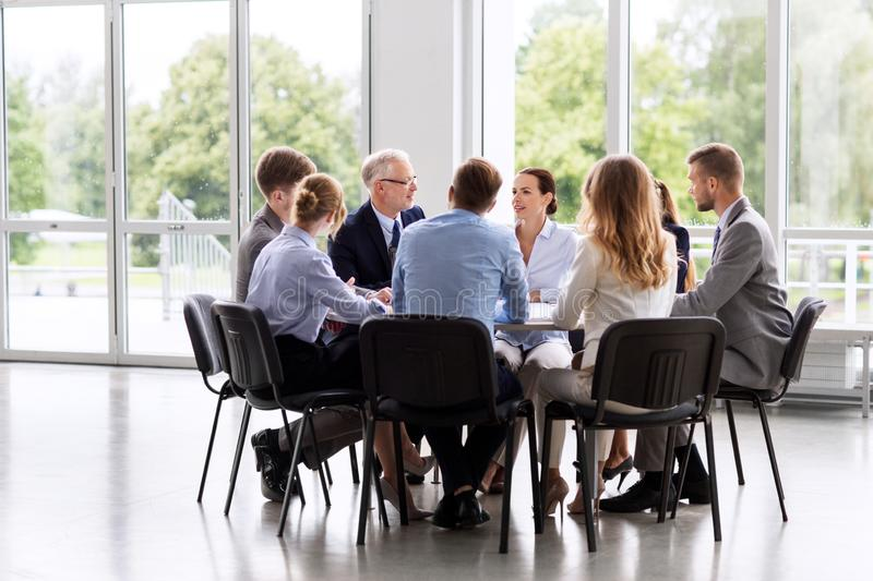 Business team meeting at office. Business, people and corporate concept - business team meeting at office royalty free stock photography