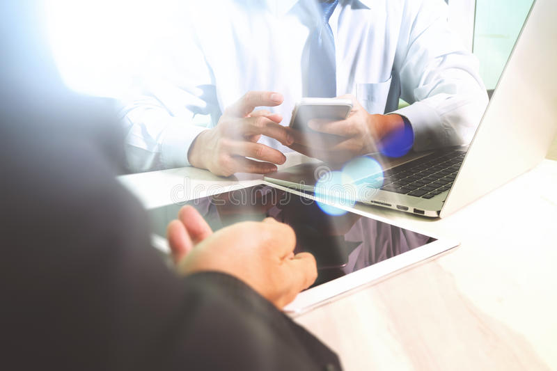 Business team meeting present. Photo professional investor working with new startup project. Finance managers meeting.Digital tab. Let laptop computer design stock image