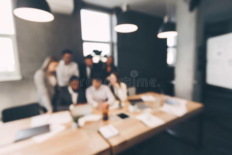 Business team in meeting room, blur background royalty free stock photos