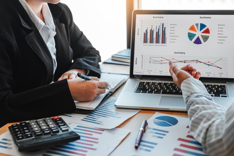 Business team meeting Strategy Planning with new startup project plan Finance and Economy Graph with laptop successful teamwork.  royalty free stock photography