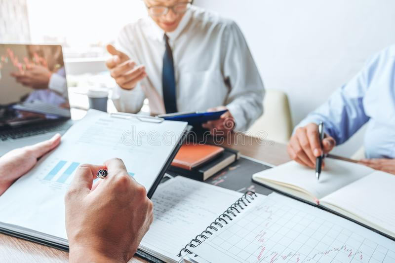 Business team meeting Strategy Planning with new startup project plan Finance and Economy Graph with laptop successful teamwork royalty free stock image