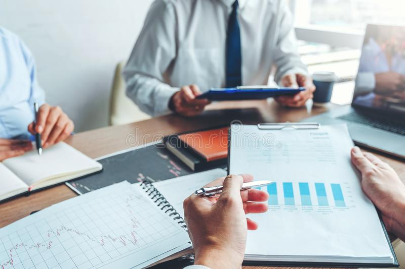 Business team meeting Strategy Planning with new startup project plan Finance and Economy Graph with laptop successful teamwork.  stock photo