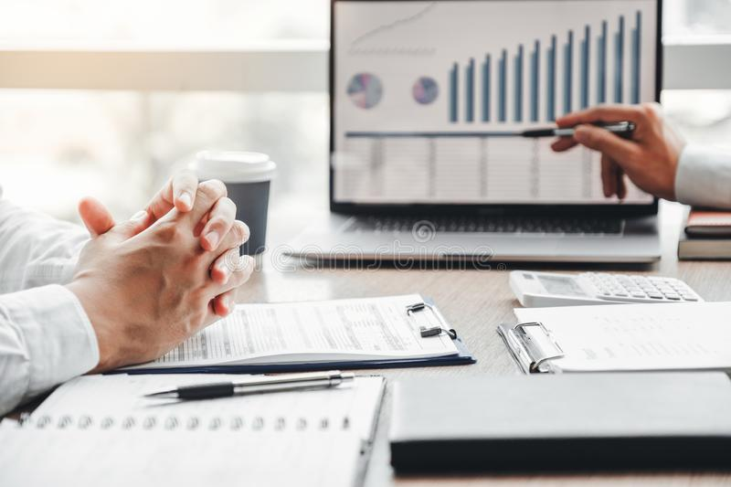 Business team meeting Strategy Planning with new startup project plan Finance and Economy Graph with laptop successful teamwork stock photo