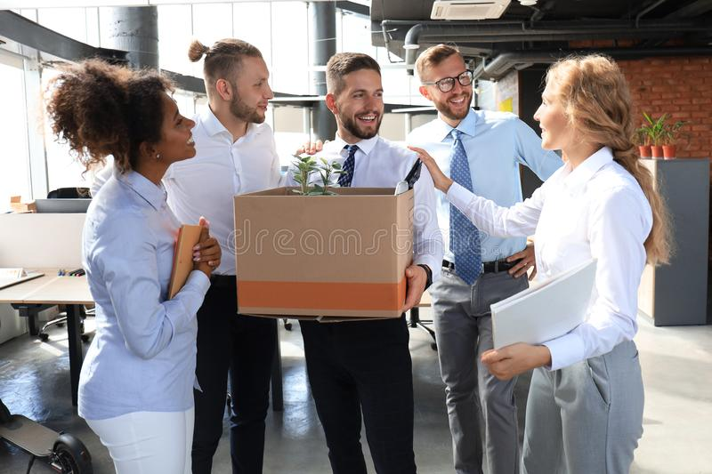 Business team meets a new employee in modern large office stock photography