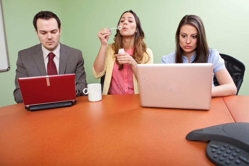 Business team member goofing off. And not pulling her weight stock image