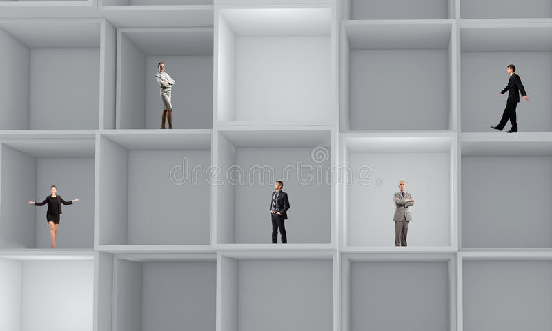 Business team. Miniatures of business people standing in cube stock photos