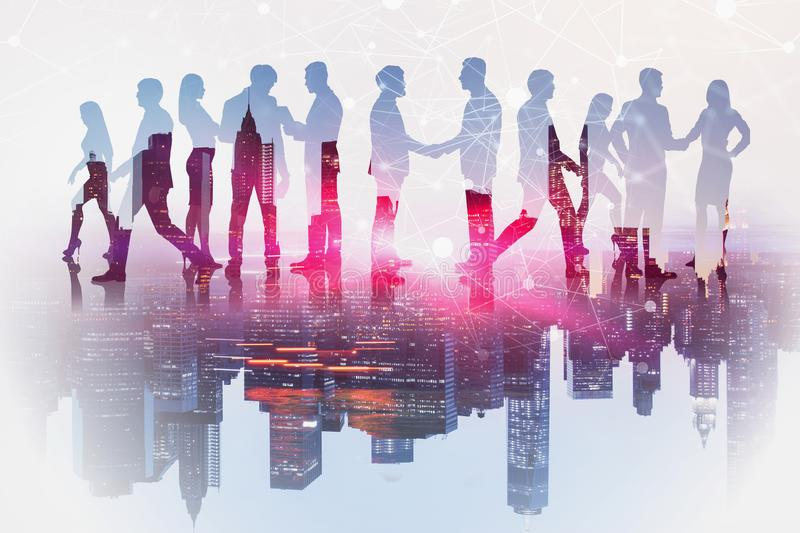 Business team and network interface in city. Silhouettes of business people shaking hands and communicating over cityscape background with network hologram royalty free stock photography