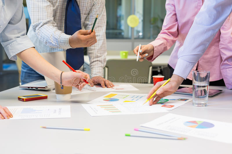 Business Team networking - office Table with Charts and People Hands royalty free stock images