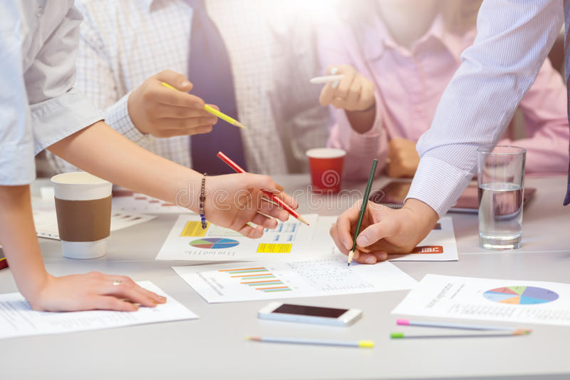 Business Team networking - office Table with Charts and People Hands stock images