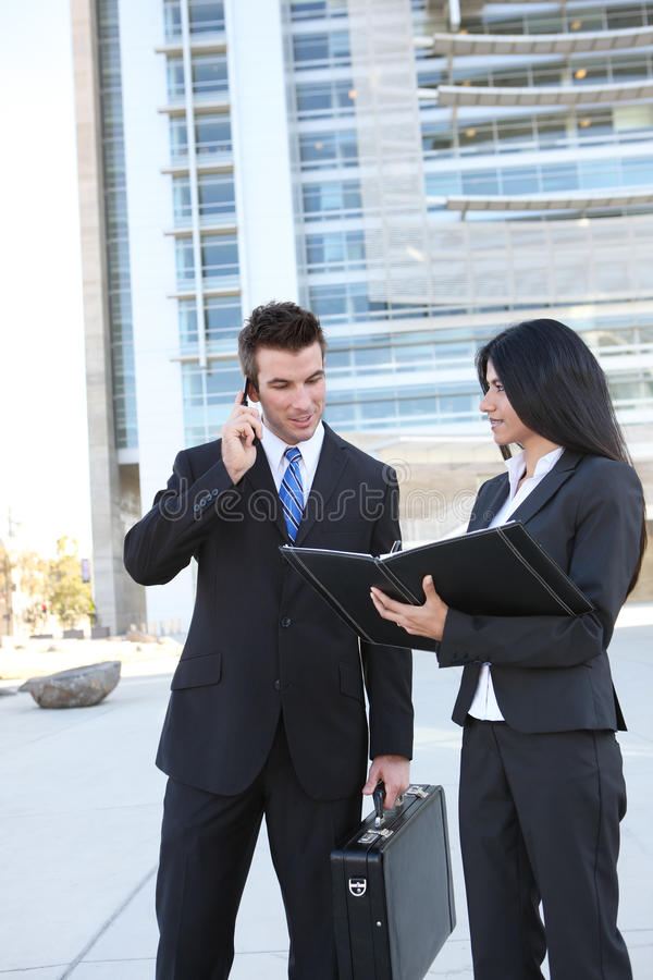 Business Team at Office. Ethnic man and woman business team at office building stock image