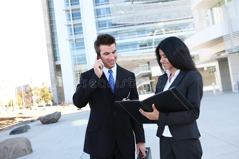 Business Team at Office. Ethnic man and woman business team at office building royalty free stock photography