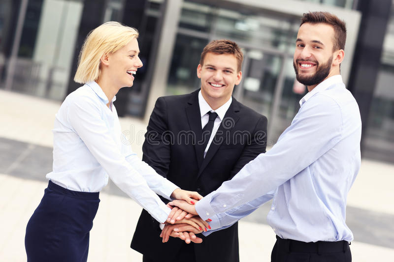 Business team outside modern building. A picture of a business team outside modern building stock images