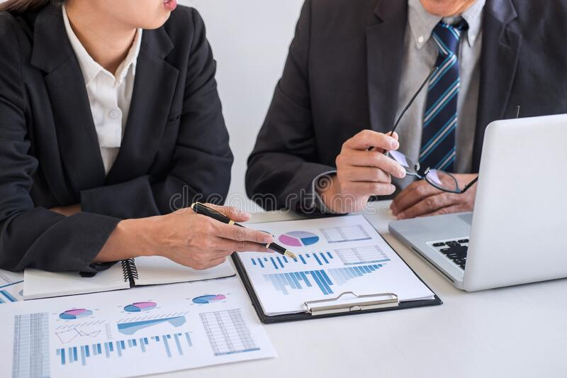 Business team partner meeting working and negotiation analyzing with financial data and marketing growth report graph presentation stock photo