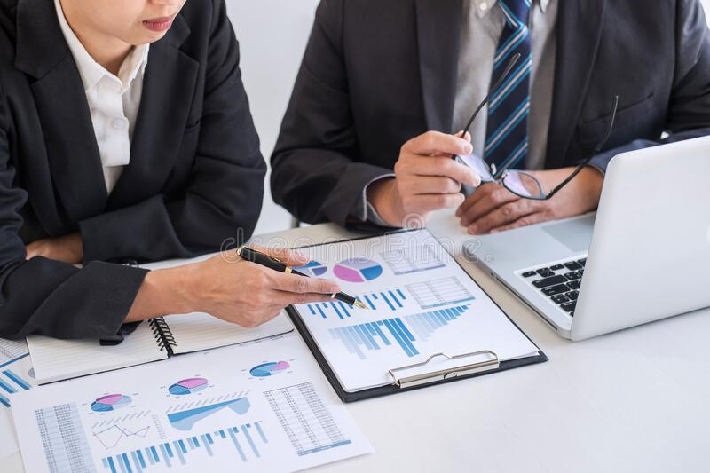 Business team partner meeting working and negotiation analyzing with financial data and marketing growth report graph presentation royalty free stock image
