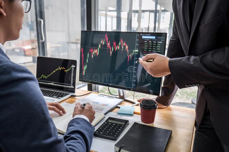 Business team partner working with computer, laptop, discussion and analyzing graph stock market trading with stock chart data stock images