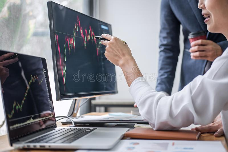 Business team partner working with computer, laptop, discussion and analyzing graph stock market trading with stock chart data royalty free stock photos