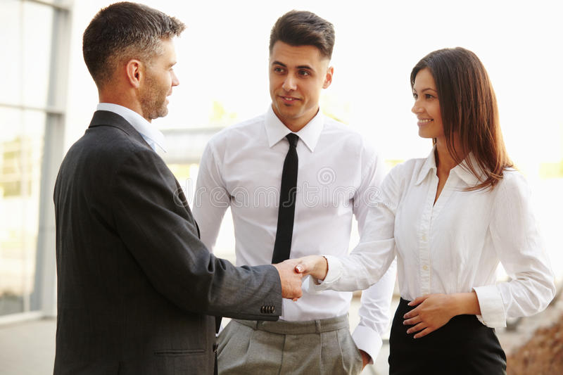 Business Team. People shake hands communicating with each other.  royalty free stock photo
