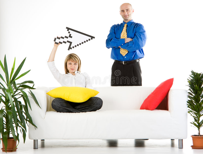 Business Team with Pointer. A business man and woman sitting on a couch with a mouse icon pointer stock photos
